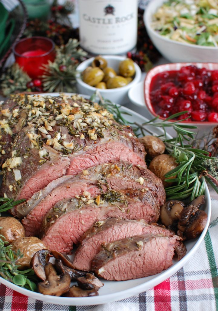 Rosemary and Garlic Roast Beef with rosemary sprig