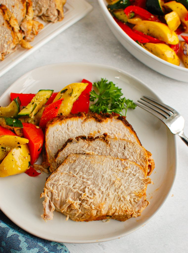 How to Cook Pork Loin in the Slow Cooker on white plate