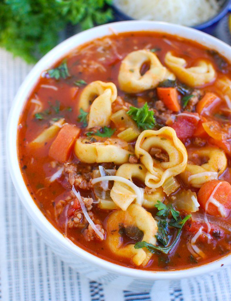 Tortellini Sausage Soup in white bowl
