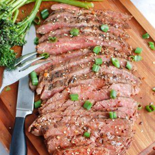 Asian Marinated Flank Steak on cutting board