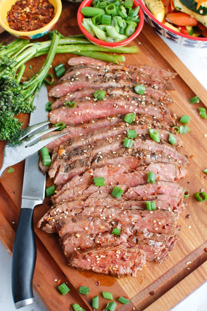 Asian Marinated Flank Steak on cutting board