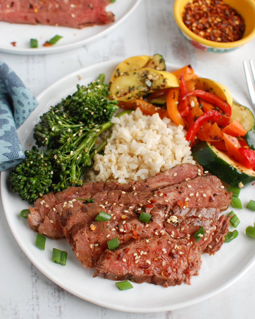 Asian Marinated Flank Steak with a fork.