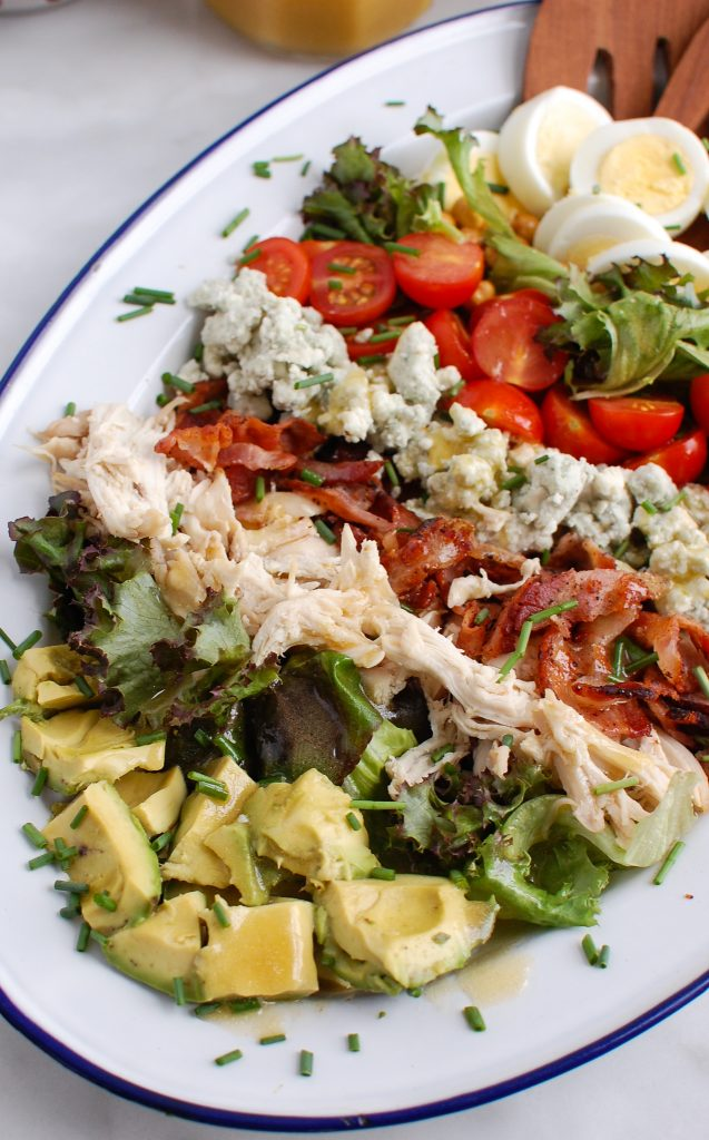 Cobb Salad Recipe with wooden tongs