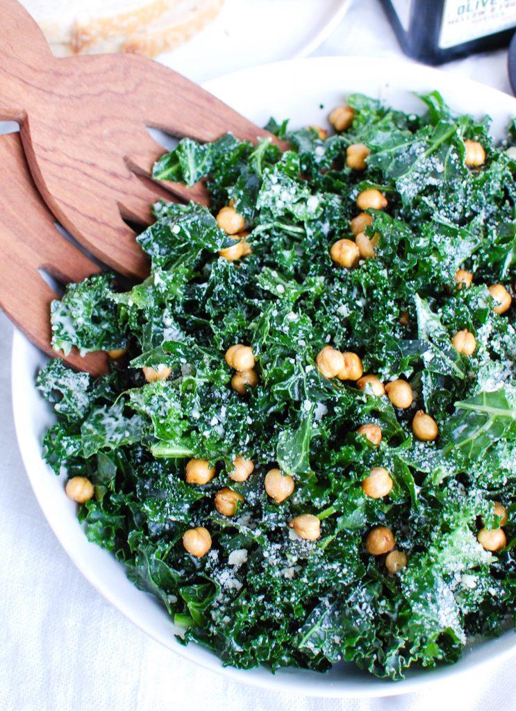 Kale Caesar Salad with wood tongs