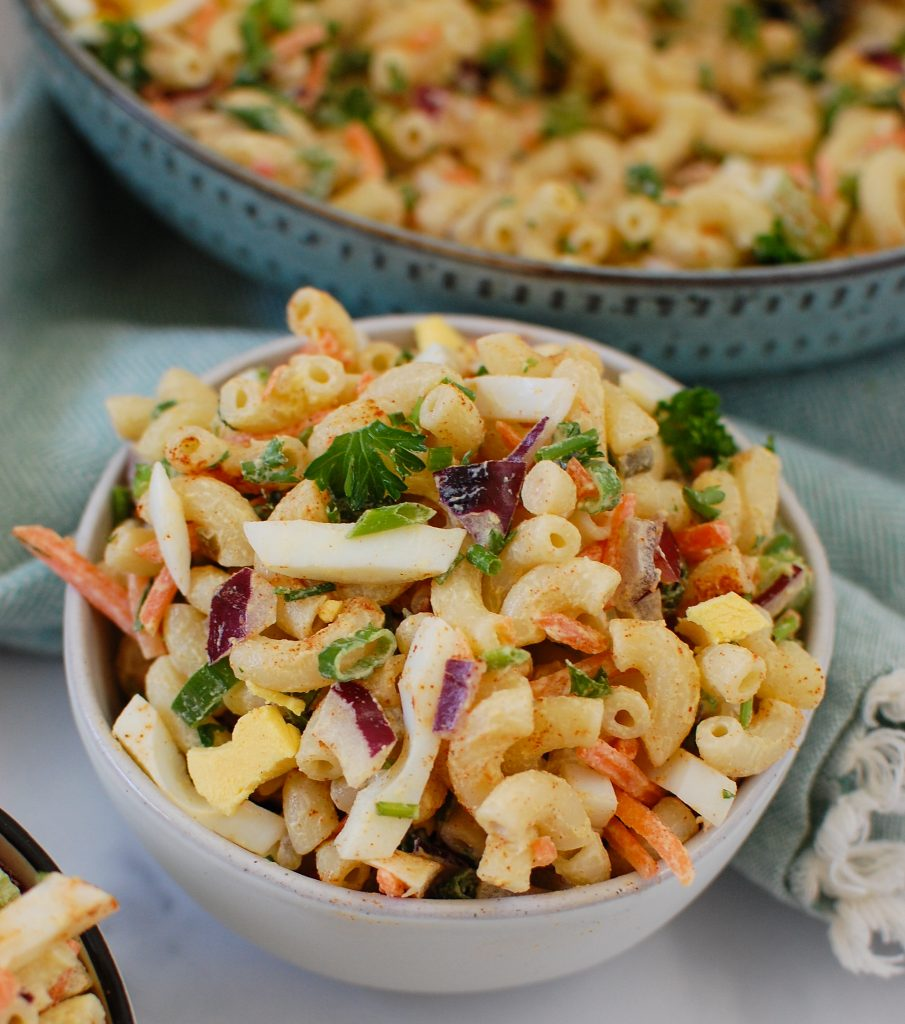 The Best Macaroni Egg Salad in a small white bowl