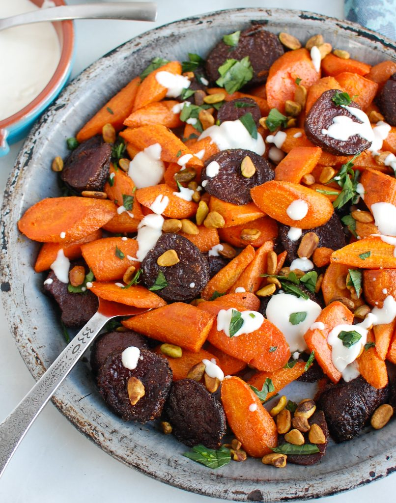 Roasted Carrots and Beets with Tahini with serving spoon