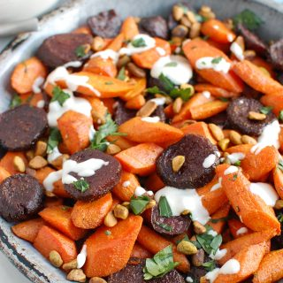 Roasted Carrots and Beets with Tahini on metal plate