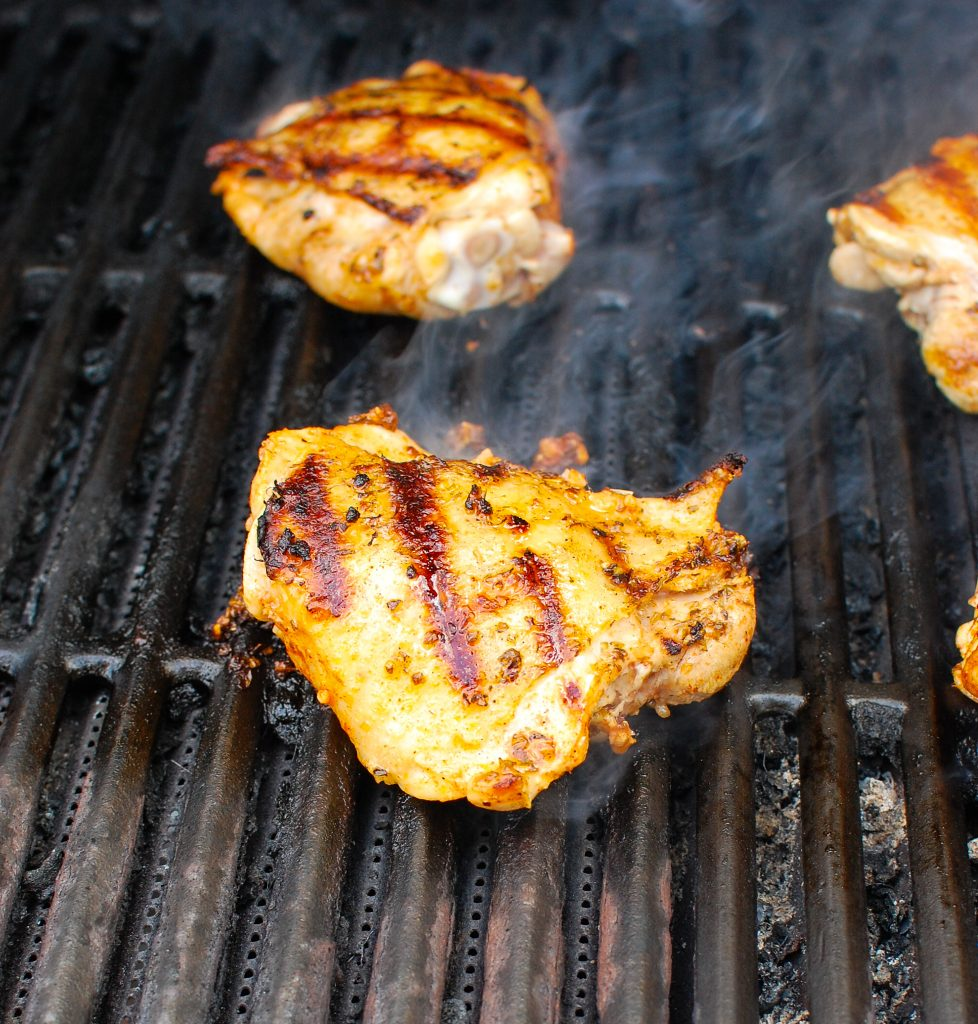 Grilled Chicken Thighs with Greek Marinade on grill