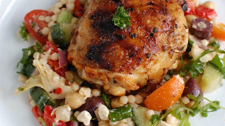 Grilled Chicken Thighs with Greek Marinade on white plate