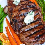 Lemon Garlic Butter Ribeye Steaks with Logo
