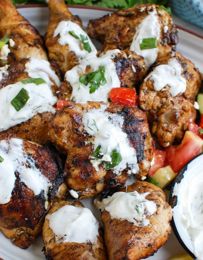 Mediterranean Grilled Chicken with Dill Greek Yogurt Sauce on platter