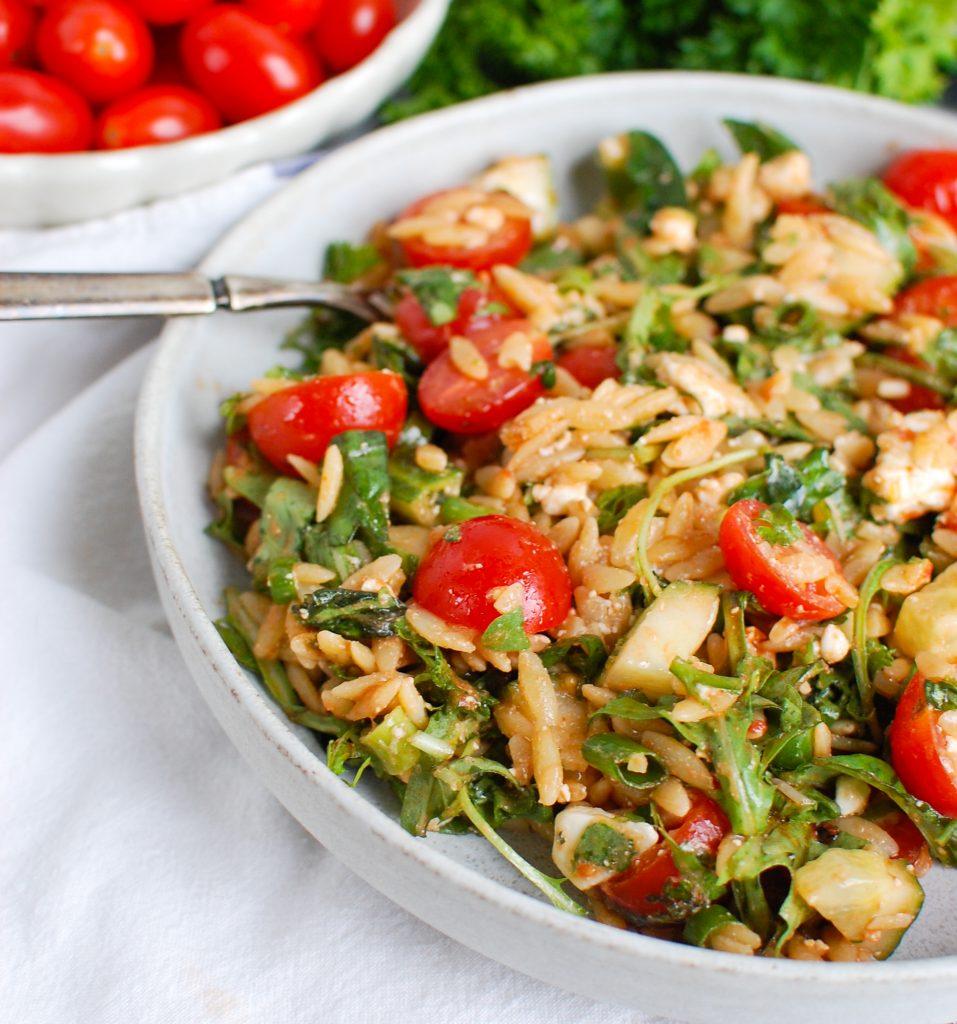 Tomato Feta Orzo Salad with fork