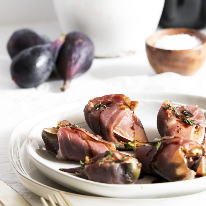 Goat Cheese Figs Wrapped in Prosciutto on plate