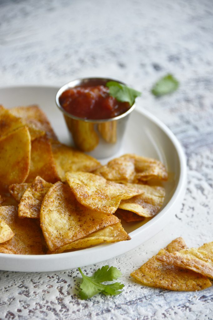 Homemade Baked Tortilla Chips on white plate