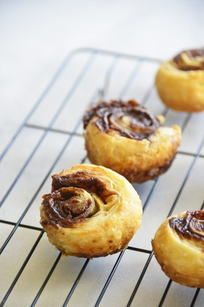 Puff Pastry Cinnamon Swirls on wire rack