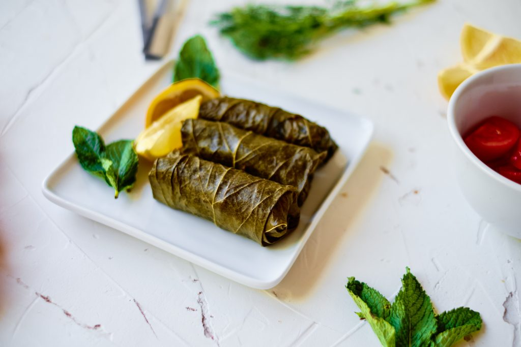 Stuffed Grape Leaves on white board