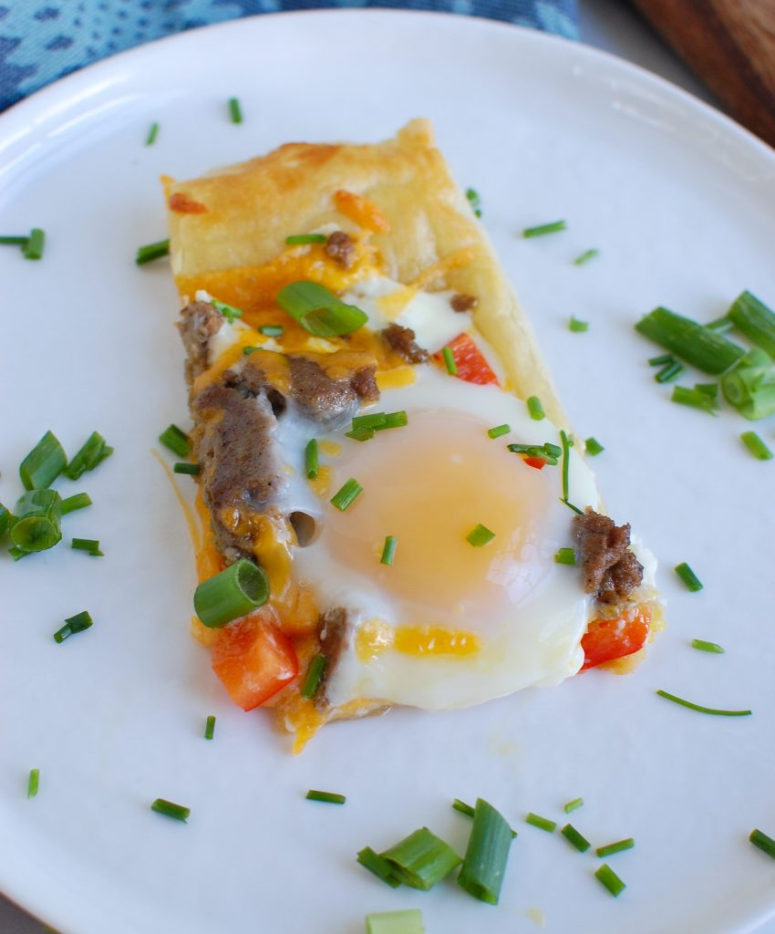 Turkey Sausage and Egg Puff Pastry Pizza on white plate