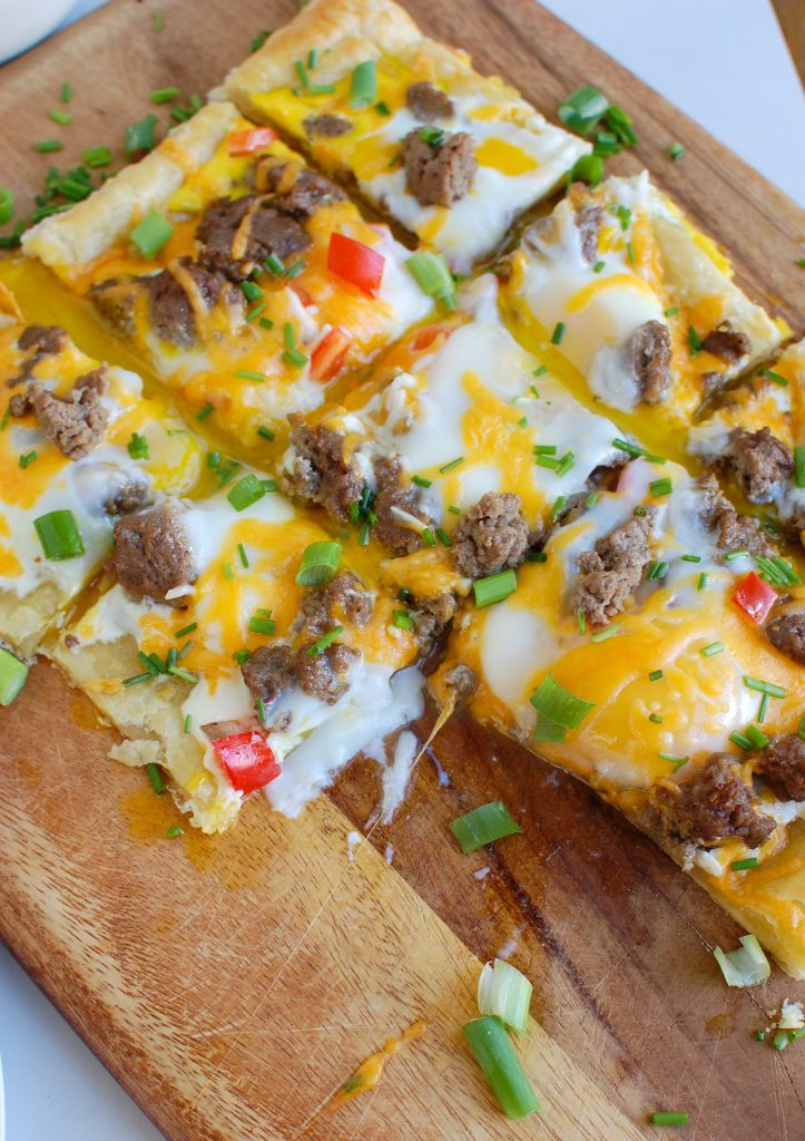 Turkey Sausage and Egg Puff Pastry Pizza on cutting board