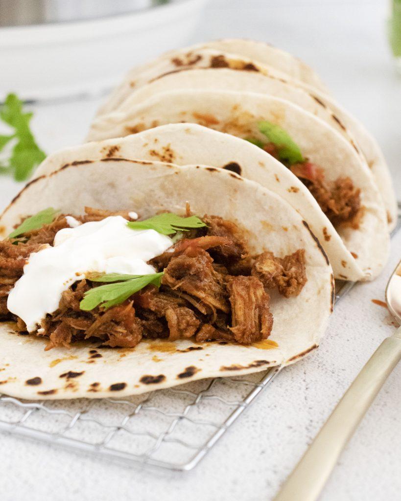 Instant Pot Carnitas Recipe in tacos