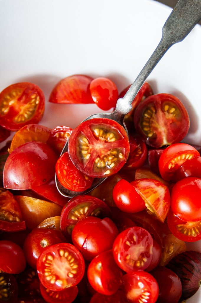 Simple Marinated Tomatoes in a white bowl