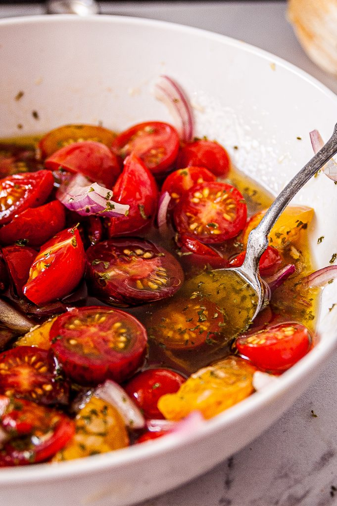 Simple Marinated Tomatoes with spoon
