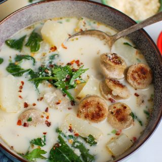 Slow Cooker Zuppa Toscana with spoon