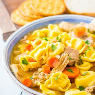 Chicken Tortellini Soup in blue bowl