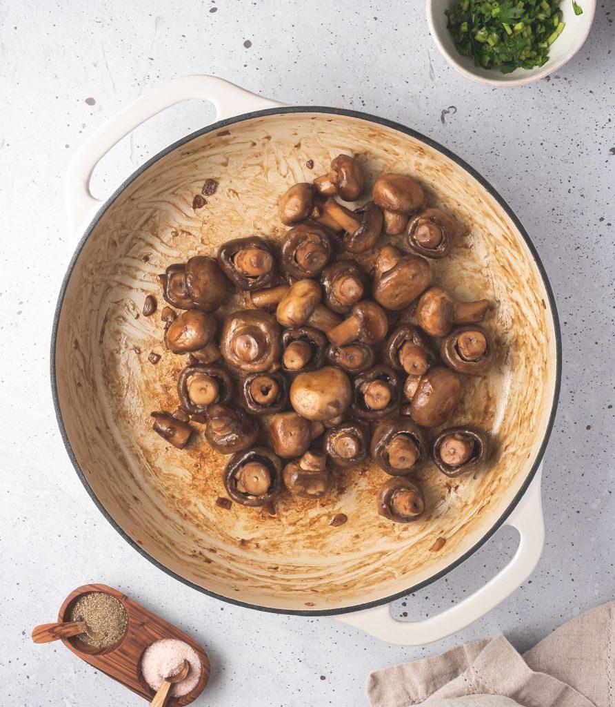 Garlic Sautéed Mushrooms in pot with oil