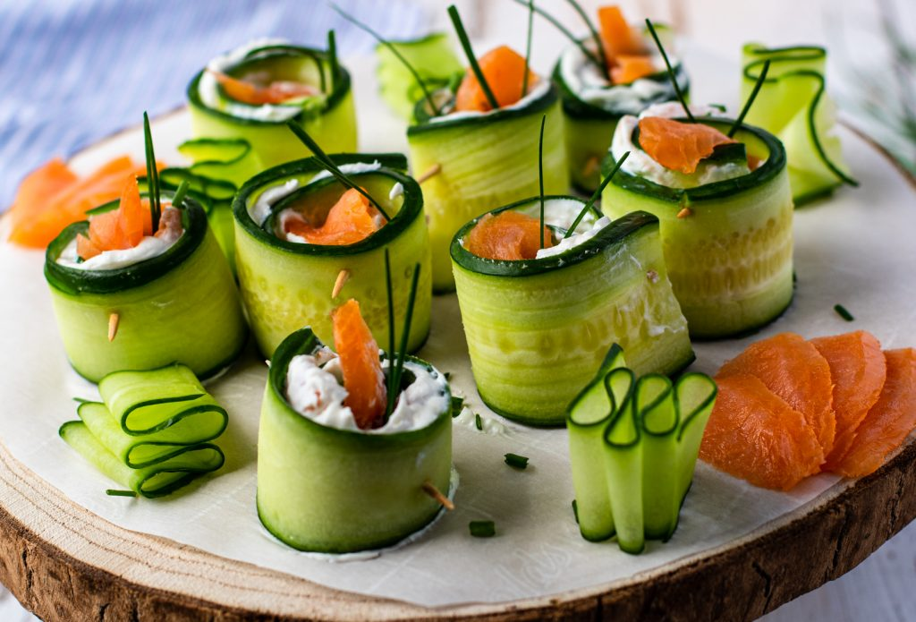 Smoked Salmon Cucumber Appetizer Bites on a wood platter