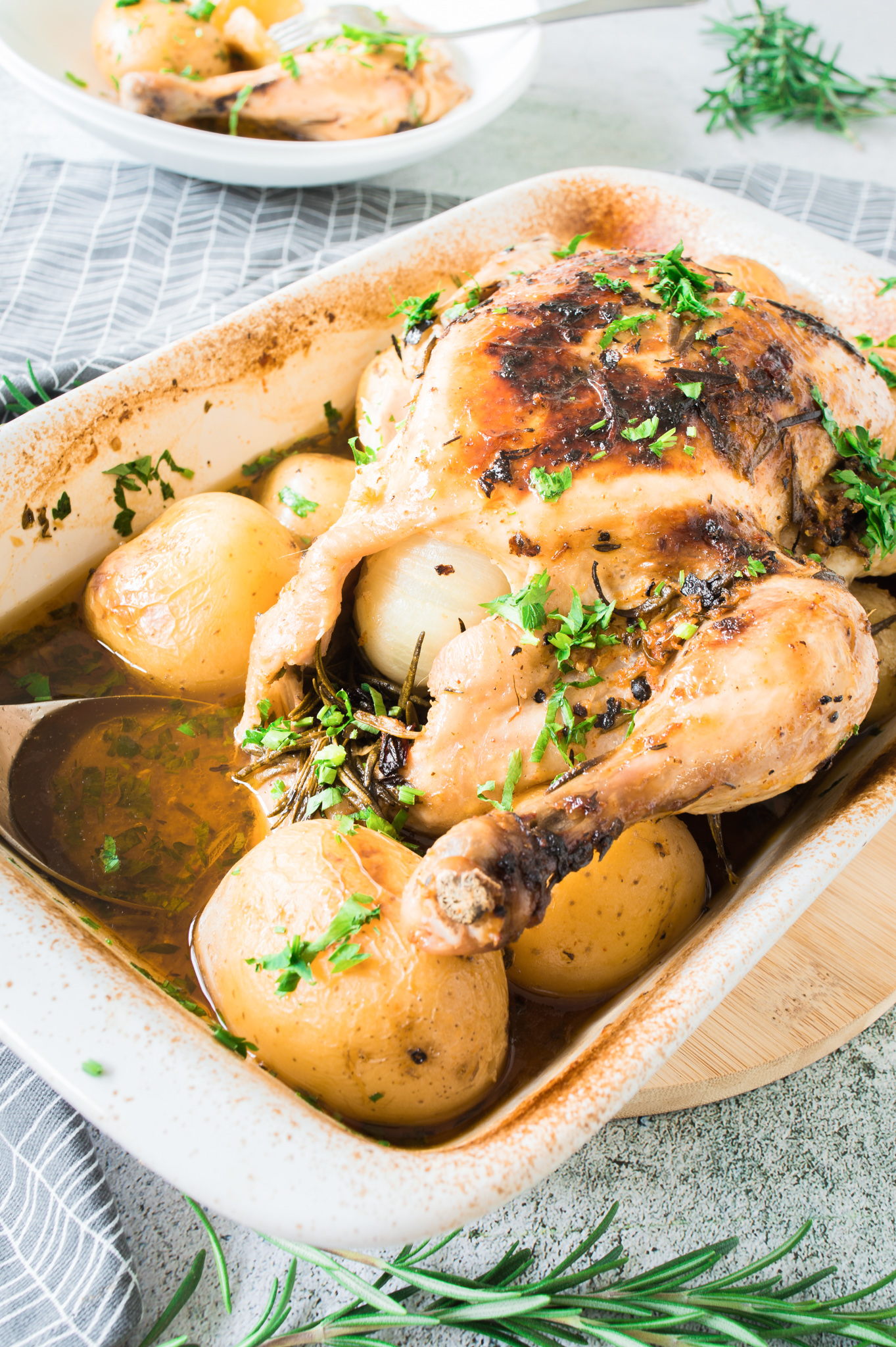 Whole Roasted Chicken with Potatoes in pan