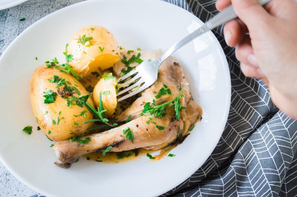 Whole Roasted Chicken with Potatoes with fork