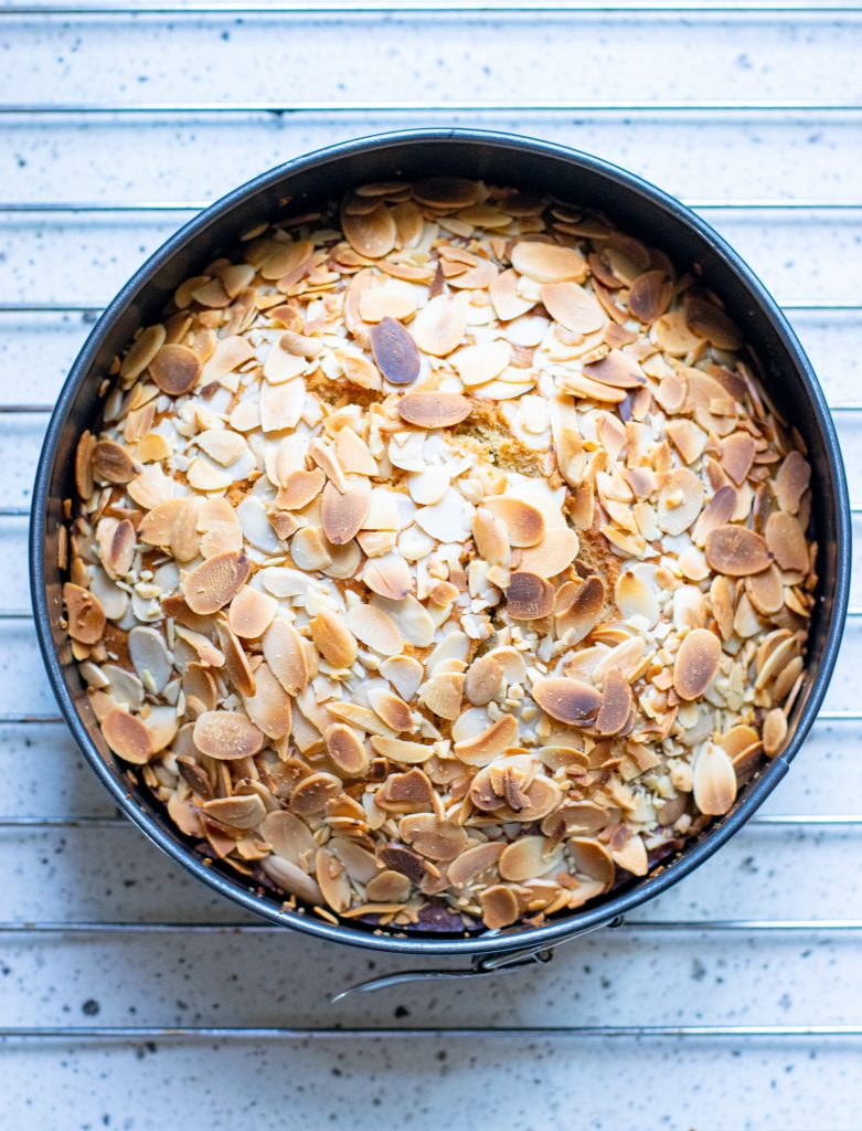 Almond Cake Recipe in pan with almonds