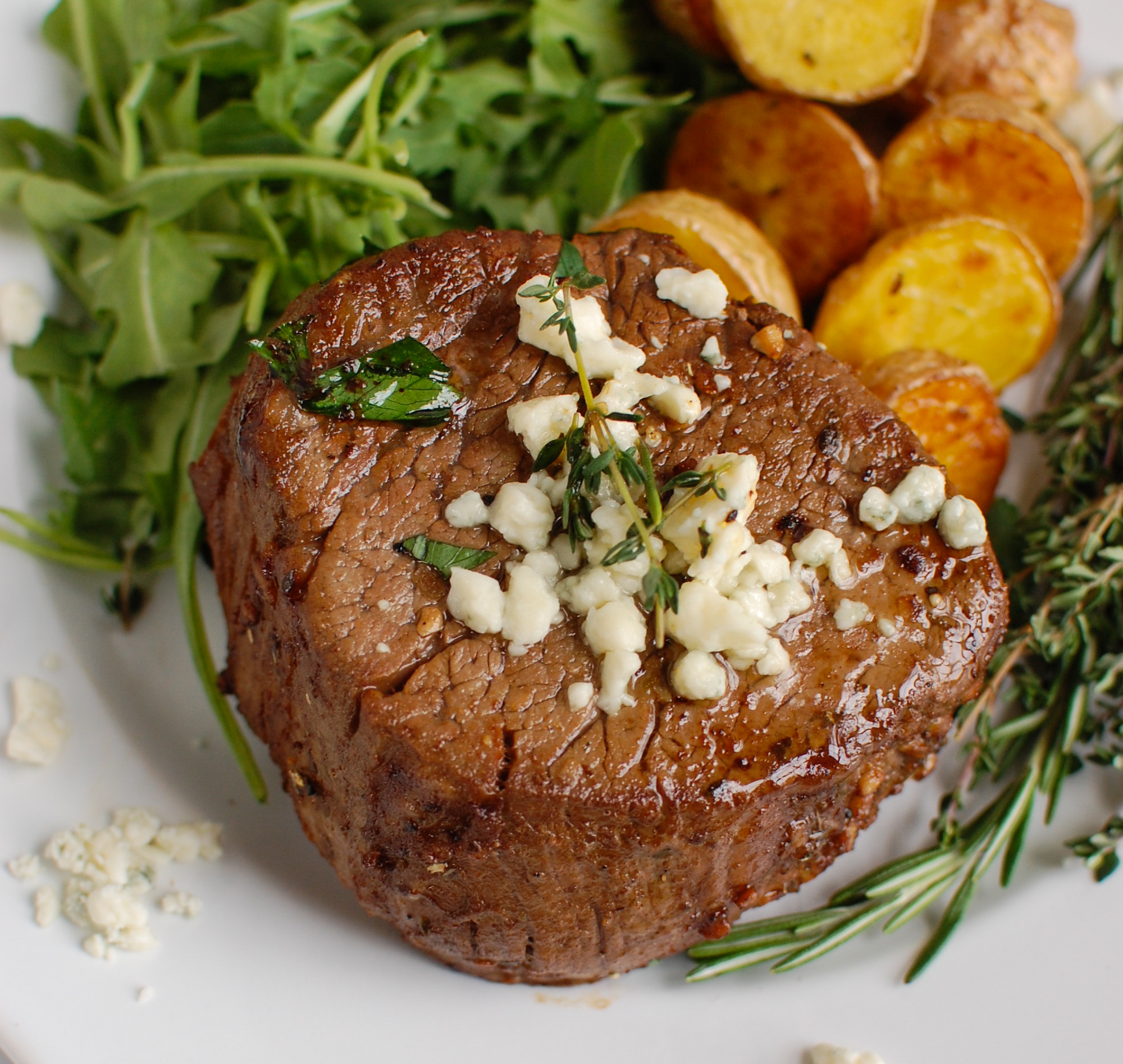 Beef Tenderloin Steaks with Creamy Blue Cheese Sauce with rosemary