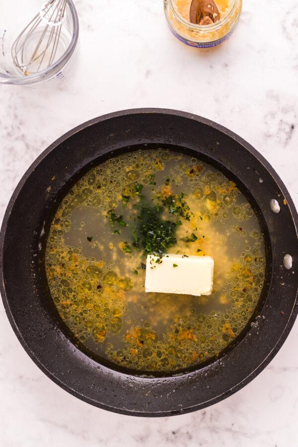 Pan Fried Garlic Butter Cod in skillet