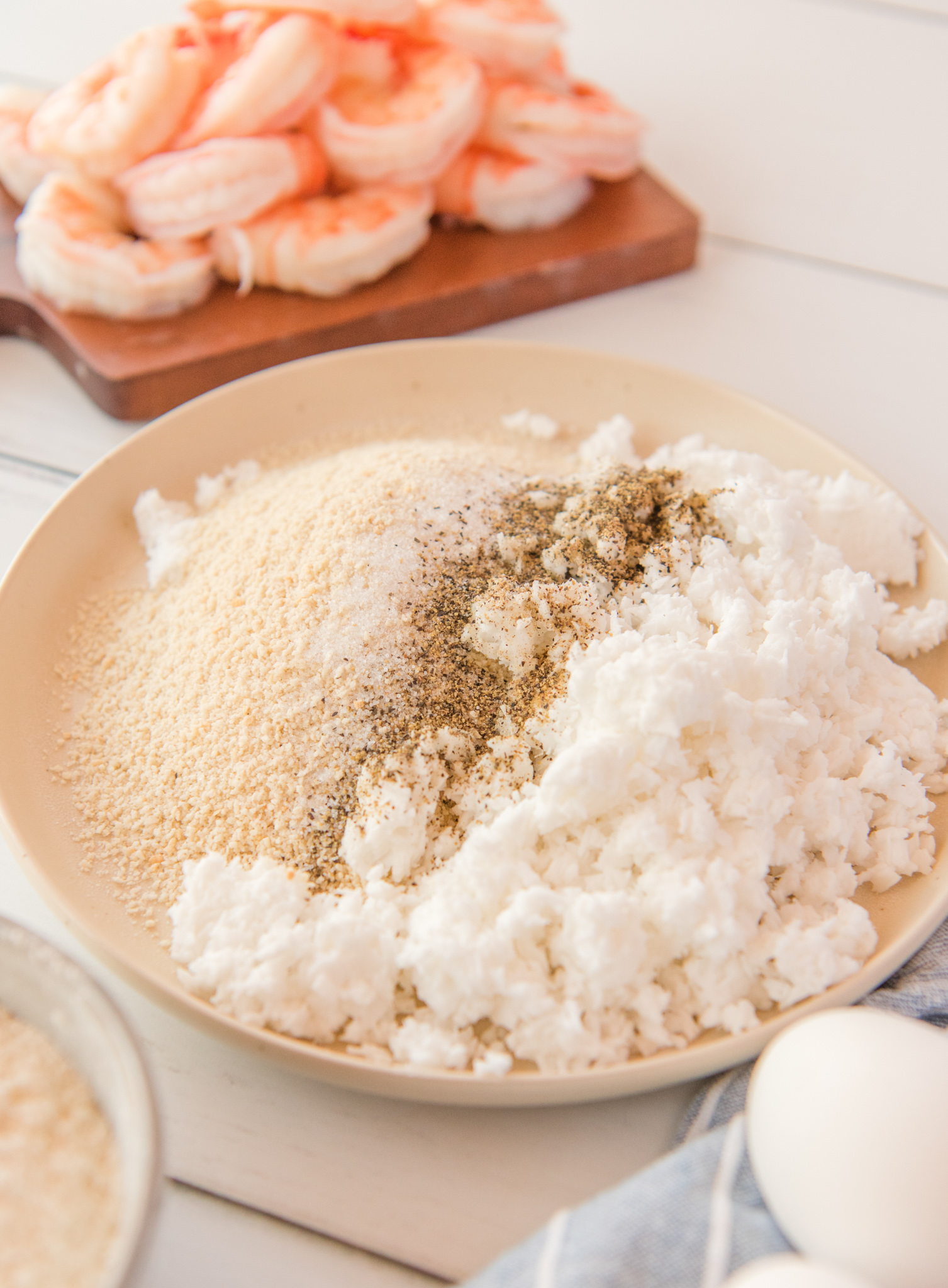 Air Fryer Coconut Shrimp ingredients in a bowl.