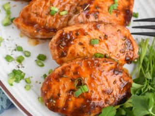 BBQ Baked Pork Chops on a white platter.