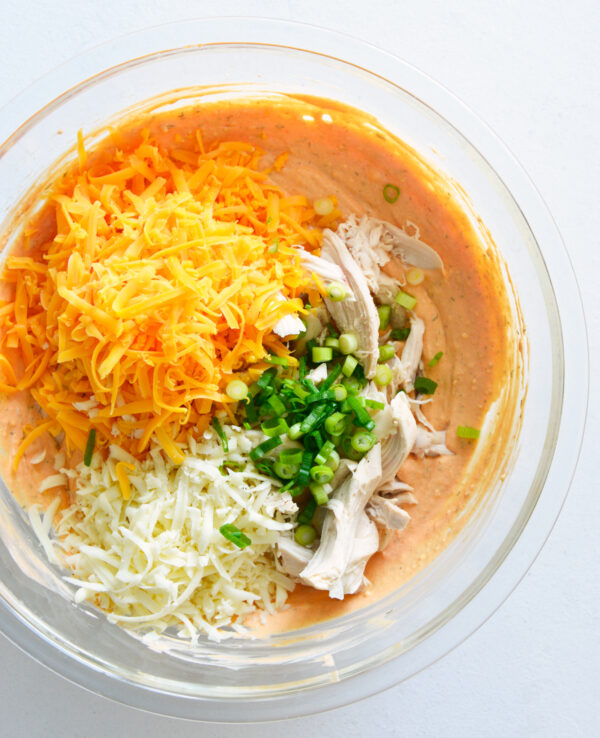 How to Make Buffalo Chicken Dip ingredients in a bowl