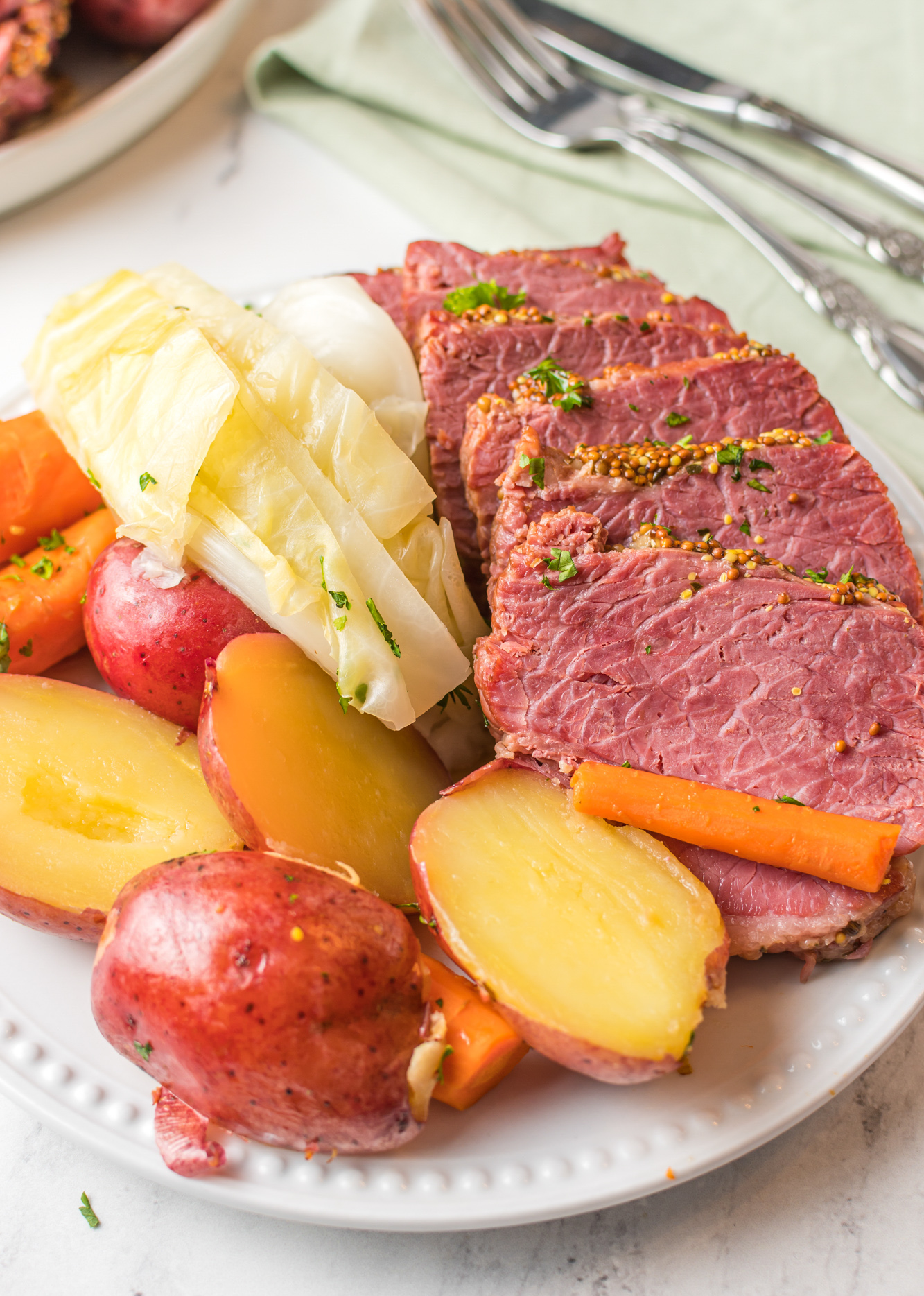Instant Pot Corned Beef and Cabbage on white platter