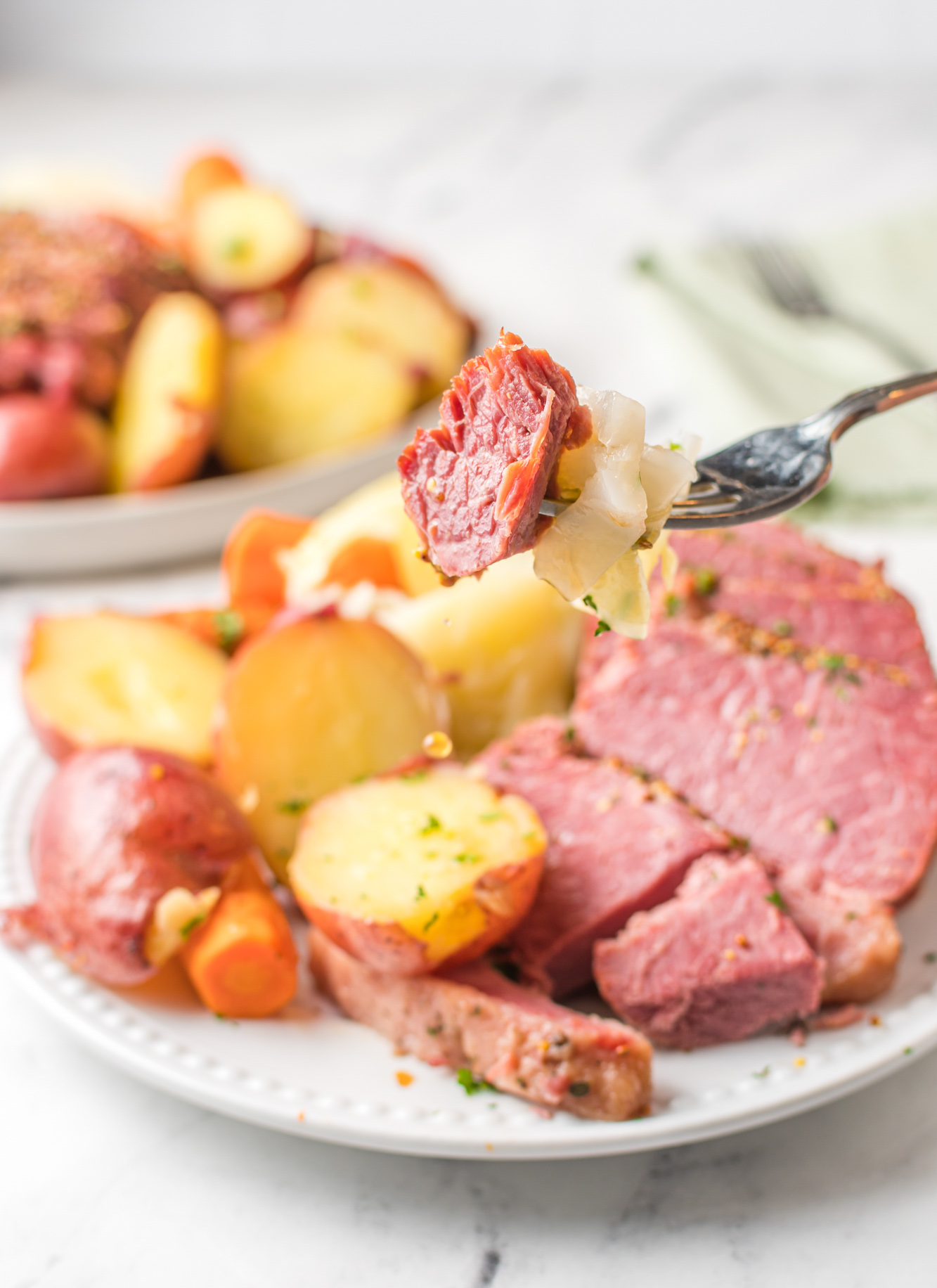 Instant Pot Corned Beef and Cabbage with fork