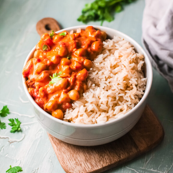 Chickpeas with Curry in a bowl with rice.