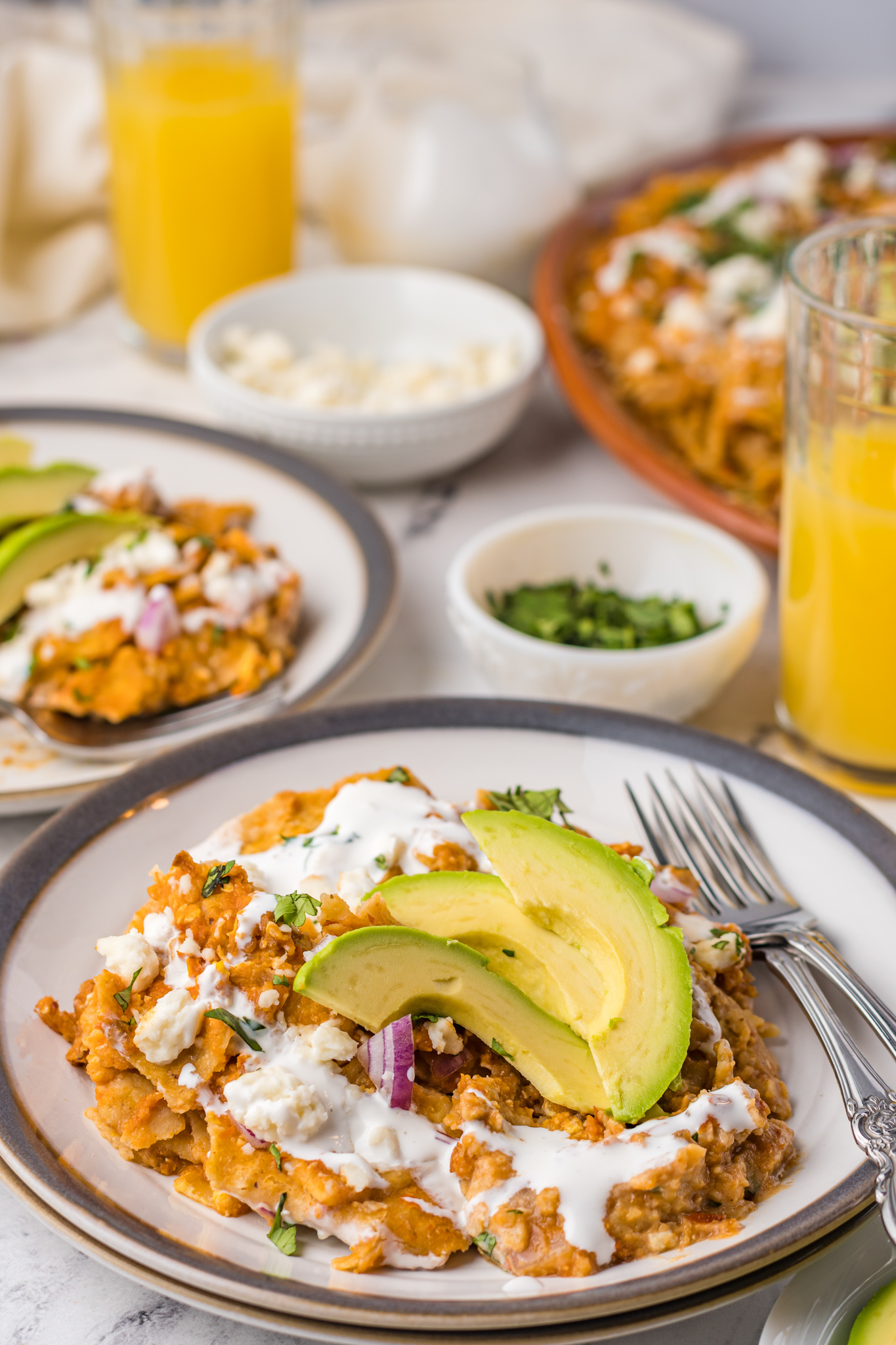 Chilaquiles Rojos Recipe on a plate with fork.