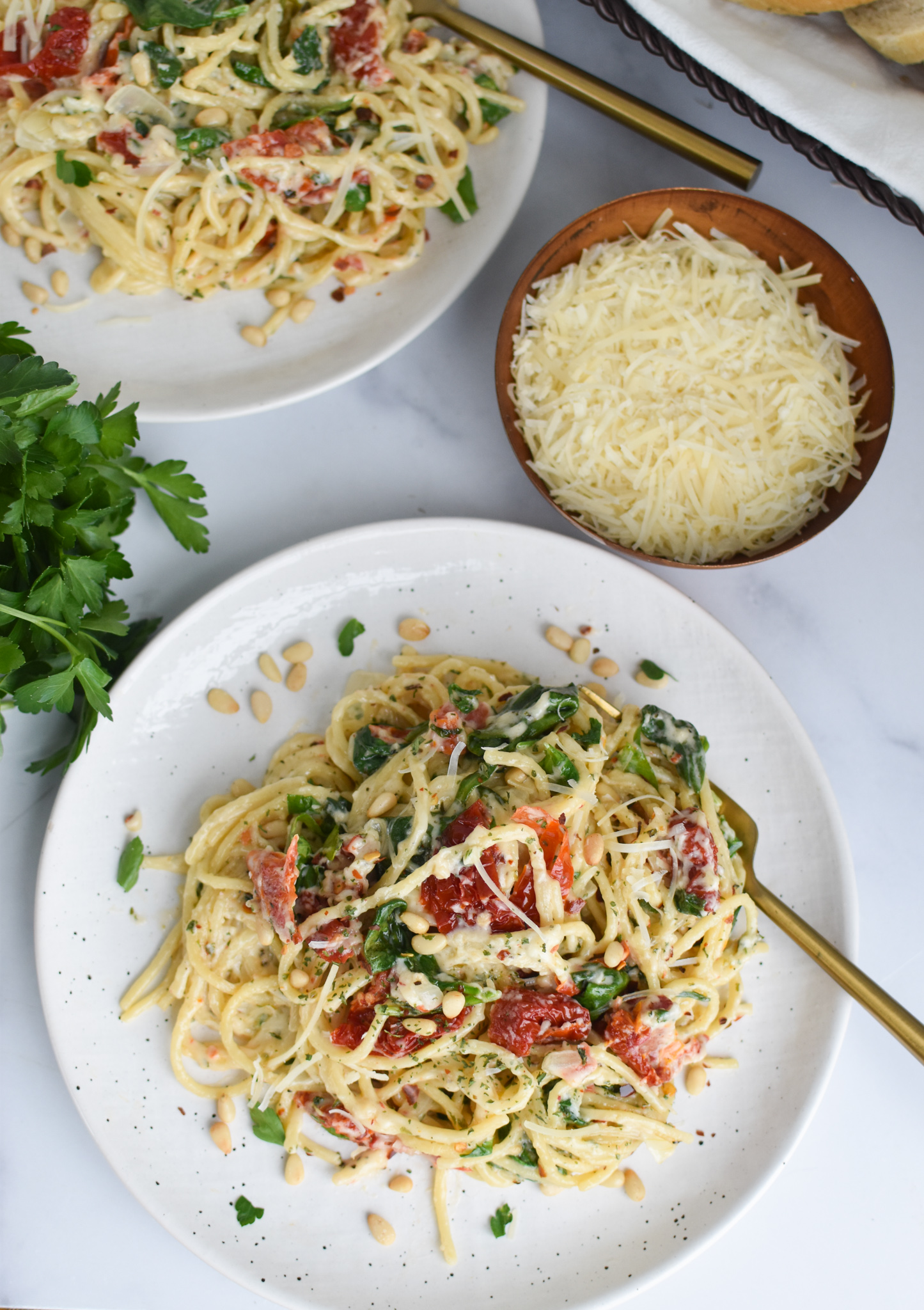 Creamy Sun Dried Tomato Pasta Recipe with gold fork.