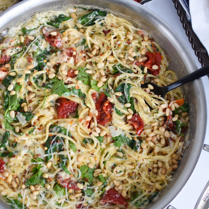 Creamy Sun Dried Tomato Pasta Recipe with a spoon in the pan.