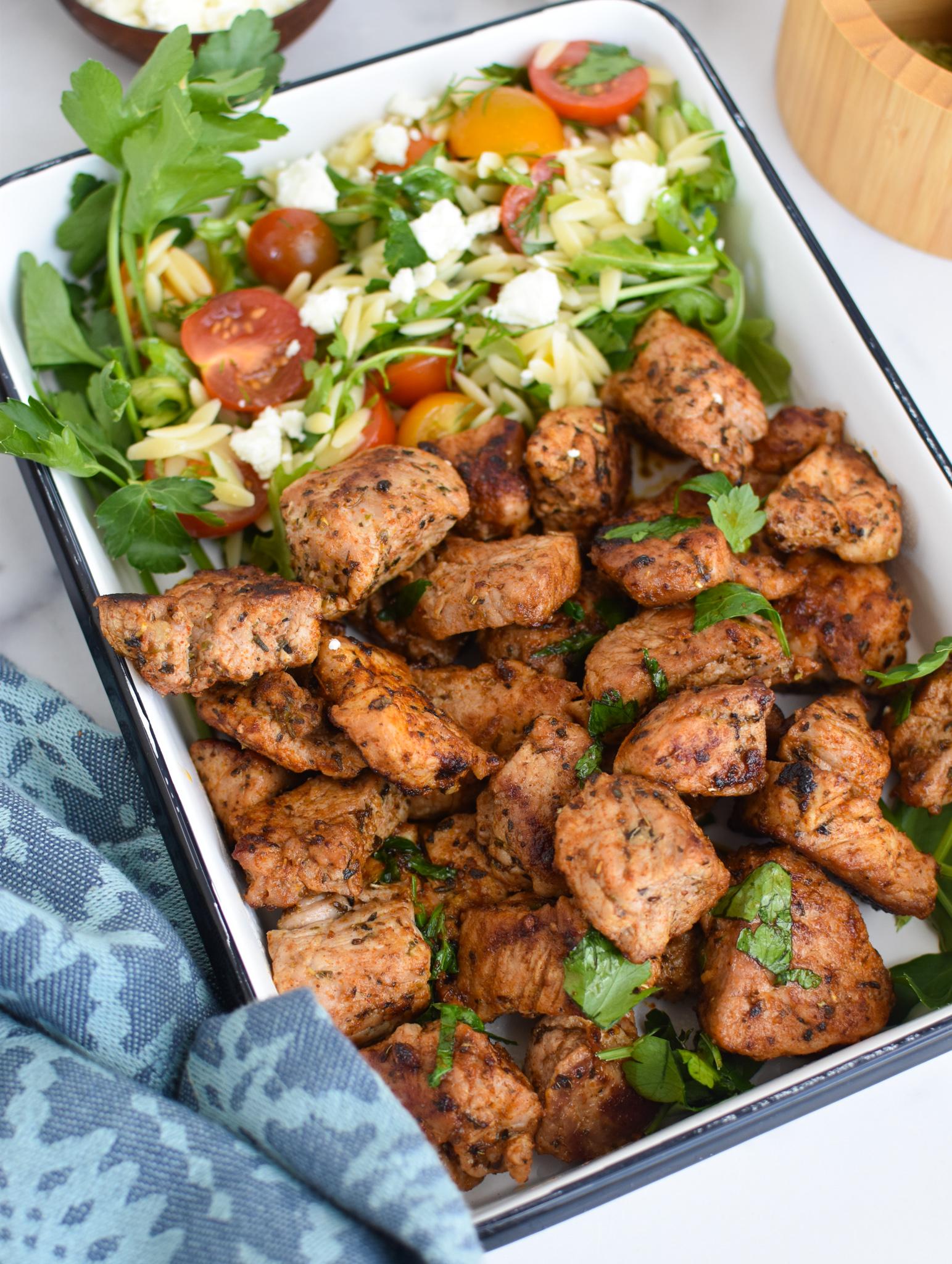Cast Iron Pork Tenderloin in a white square dish.