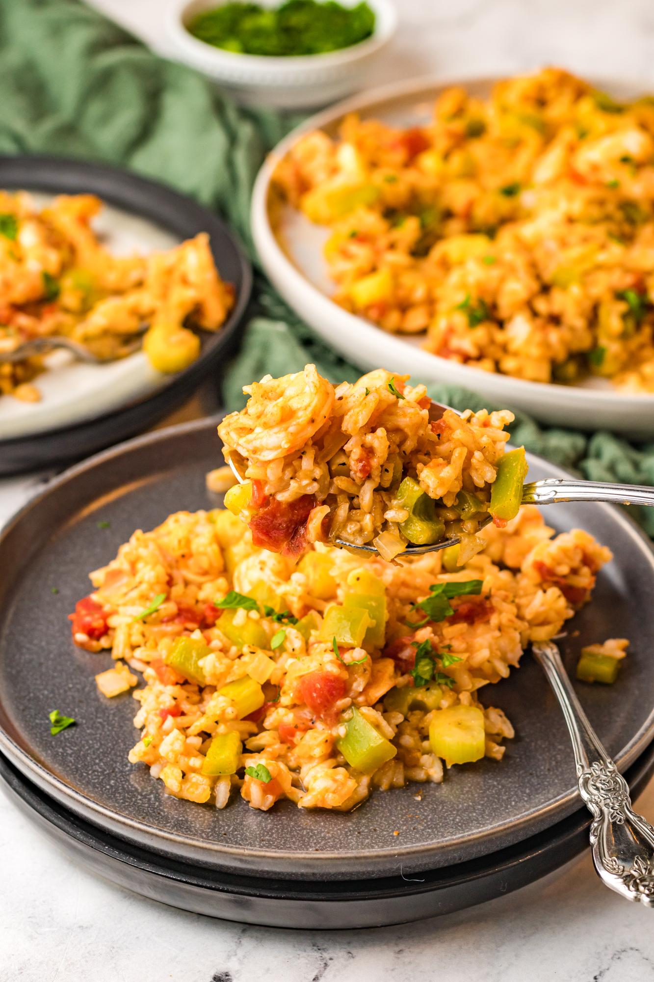 Shrimp Creole Recipe on black plate.