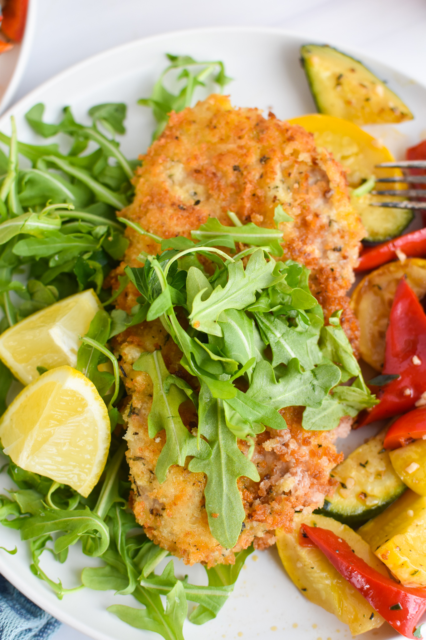 Easy Veal Milanese Recipe with arugula.