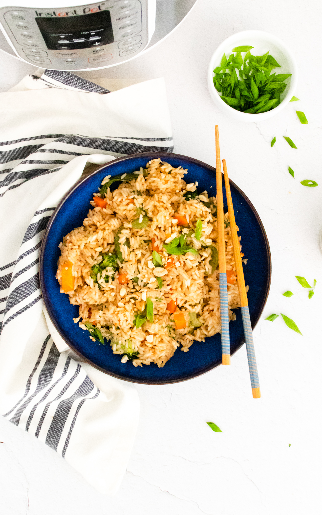 Instant Pot Fried Rice with chopsticks in a blue bowl.