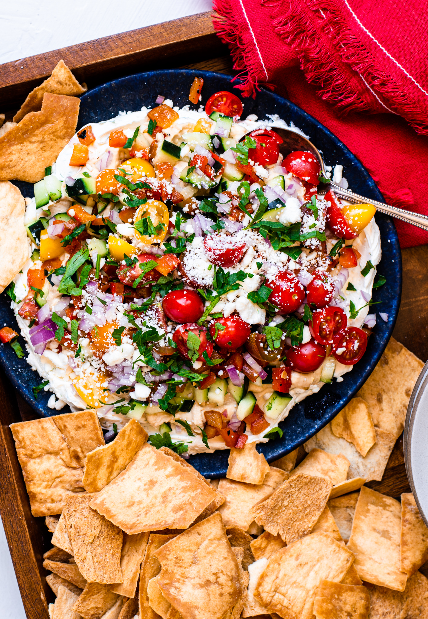 Layered Greek Dip with pita.