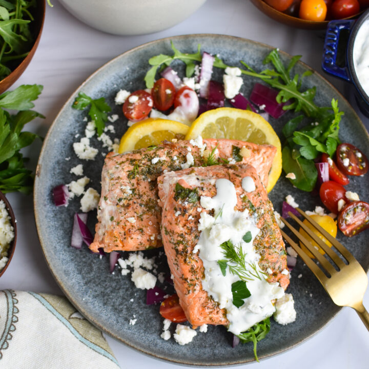 Pan Seared Greek Salmon on a blue plate.