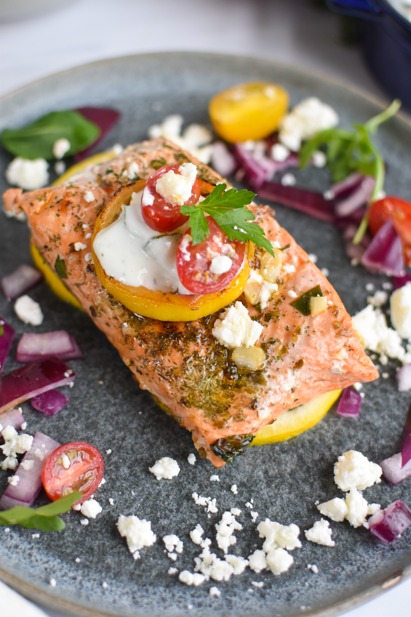 Pan Seared Greek Salmon with lemon slice.
